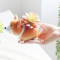 I need these in my life. STAT! Mini Corgi Planter Pots