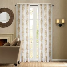 """Give your room a new look with the Madrid window panel. The panel is made of luxurious sheer fabric with chain-stitch embroidery in a beautiful gold scroll medallion motif. The top treatment is rod pocket detail and will fit up to 1.25"""" diameter rod. The panel comes in 84"""" and 95"""" length."""