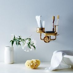 We love the industrial vibe of this  brass sink caddy from the Food52 shop.