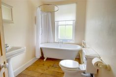 Good size family bathr oom with double ended roll top bath and a fitted shower over the bath. Devon Cottages, Roll Top Bath, Old Bathrooms, Traditional Bathroom, Bathtub, Shower, Bathroom Ideas, House, Image