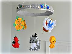 A Game of Thrones mobile - Wolf, lion, dragon, stag, falcon, kracken, flower, sun, crown - Geekery - Fantasy - baby mobile - Made to order. $375.00, via Etsy.
