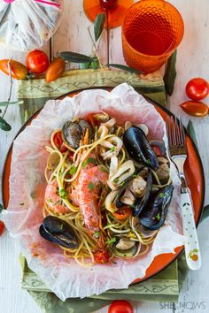 Seafood Spaghetti Baked In Parchment Pouches For A Simple Yet Elaborate Meal  _ Enclose your seafood pasta dinner in parchment paper pouches, & the flavors & aroma mingle while they bake. If you skip the baking in the pouches, then you will miss a big part of what makes this dish so tasty. All you need is one whiff of the steam & you will understand what all the extra work was for!