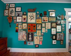 this mix of art and objects on the turquoise wall is spot on -- hard look to create but one of my favorites...