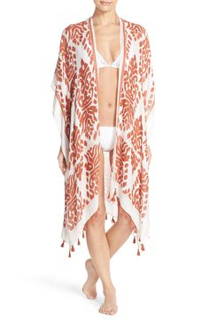 Dramatic fringe trims the hem of this flowing open-front kimono cover-up in a bold monochrome print.