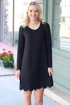 Amazingly soft suede-like texture makes this long sleeve dress with scalloped hemline super great for fall! Very stretchy. Loose, shift style dress. Black in color.