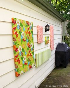Hanging outdoor wall art using vinyl tablecloth~a great way to add some color to your space