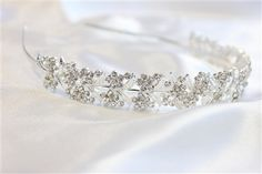 CAD$34.50 - A sparkly clear rhinestone crystal bridal hair band. It makes an elegant bridal halo, wreath or crown, with a silver wire band for styling convenience.  beautiful bridal Hair pieces, for amazing prices check out our website www.karmabridal.com
