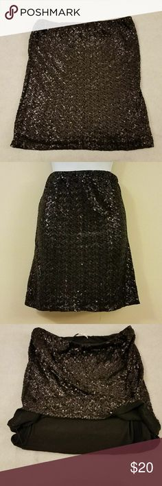 """Cabi Glitter Mini Skirt Product Description  Brand-?Cabi  Women's Size-?M  Material-?60% Cotton; 40% Rayon (Body); 95% Cotton, 5% Spandex (Lining)   A Cabi black glitter sequins mini skirt. ?Gently used. Regular wear and tear. Tagged size M but please see measurements to ensure proper fit.   Waist- approximately 30""""  Length- approximately 19""""   Please see all photos before purchasing and let me know if you have any questions!? CAbi Skirts Mini"""