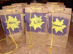 party bags- instead of brown bags, I bought purple gift bags & glued suns on them and wrote their names