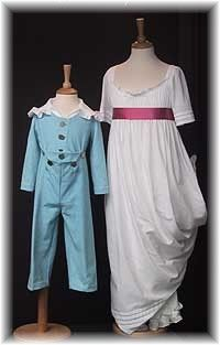 """Regency Children's Clothing. The boy's costume here is known as a """"Skeleton Suit"""" which would have been worn up to age 8 or 9, after which he might be put into breeches and waistcoat, with a relaxed long jacket. The girl's gown is made from white cotton muslin, the perennial favorite of this period. The model shown is wearing a pair of cotton lawn pantaloons, frilled with voile at the legs, attached to a small bodice. The silk sash was an indispensable part of this look."""