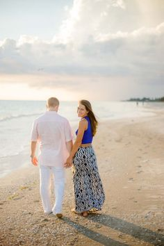 Beach Engagement Session - Fun Tennis Engagement Session - Photo by Megan Pitts Photography - click pin for more - www.orangeblossombride.com