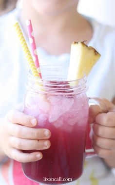 This raspberry crush is the best party punch recipe. It's non - alcoholic so all guests can enjoy! Easy party punch recipes