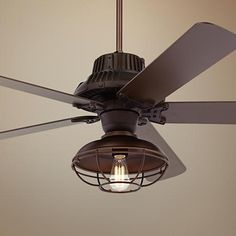 A handsome caged light kit completes the industrial look of this outdoor ceiling fan design.