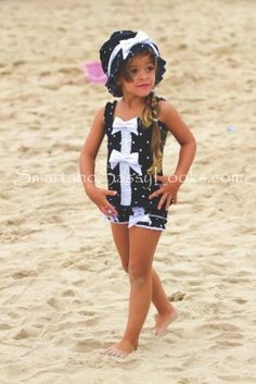 It is so hard finding a modest swimsuit for my daughter. I think this one suits a soon to be 7 yr old. Chichanella Bella Licorice Twist