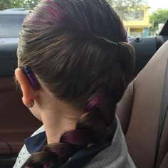 Purple hair highlights and braid with purple Phonak hearing aids