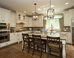 home trends Antique White Cabinets With Dark Hardwood Floors Njtqllj Antique White Kitchen Cabinets With Dark Wood Floors Discover Off White Kitchens, Home Kitchens, Kitchens With White Cabinets, Cream Cabinets, White Cupboards, Cream Kitchens, Colored Cabinets, White Counters, White Appliances