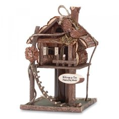 Treehouse Birdhouse birds to your neck of the woods with this fantastic wooden way-station, trimmed with twisty twigs, pinecones and a darling rough-hewn ladder. 7 x 7 x 12 high. Pine Cone Bird Feeder, Bird House Feeder, Wooden Bird Houses, Decorative Bird Houses, Bird House Plans, Bird House Kits, House Ladder, Glass Hummingbird Feeders, Birdhouse Designs