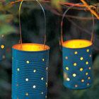Luminaries - Great for patio, or in a garden sitting space. Use tin coffee cans (or soup cans, if you hang them) and using a hammer and nail, poke holes. Use citronella candles and light them for a nighttime get-together -- they're pretty and they keep the bugs away! Painting them ensures that they stay pretty during the daylight hours as well. [paraphrased text from original post by cstbblove]
