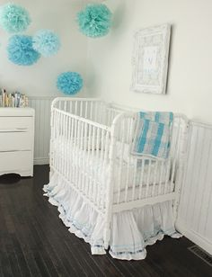 Jenny Lind crib & aqua poofs-so simple, yet perfect pop of color for this nursery