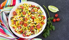 A healthy and hearty salad with corn, tomatoes, cucumbers, jalapeno, red onions, herbs and seasonings.