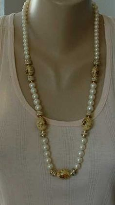 """This necklace has faux pearls and 5 beads with a transfer floral painting on them. The detail is exquisite. The necklace is 29"""" long, and the large beads are about 20 x 15 mm. The tag  reads """"Japan."""" There is some very minor age-related wear on the necklace, but you have to look closely to see it. Also, when you are holding the necklace up with your fingers there is a small amount of slack in the line, but this disappears when you are wearing it. An """"earthy,"""" beautiful necklace. ."""