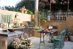 Ideal for entertaining, this outdoor living area features a terrace converted into a dining room