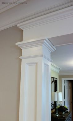 Wrapped columns and header foyer side home pinterest Crown columns