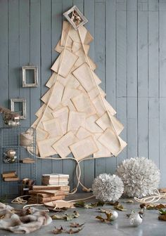 a Christmas tree of vintge book pages is idela for a book lover dwelling Christmas Tree Design, Recycled Christmas Tree, Creative Christmas Trees, Christmas Tree Themes, Christmas Diy, Bohemian Christmas, Merry Christmas, Xmas Tree, Beautiful Christmas