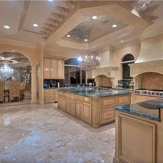 Great Kitchen Design and Ideas with Cabinets, Islands, Backsplashes – Photo Gallery – Luxury kitchen designs with very high ceiling with special beige decorations and spot lights. The kitchen has many ovens and a large wooden island in the middle of it. Luxury Kitchen Design, Dream Home Design, Luxury Kitchens, My Dream Home, Home Kitchens, Dream Kitchens, Tuscan Kitchens, Beautiful Kitchens, Beautiful Homes