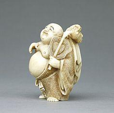ANTIQUE JAPANESE CARVED IVORY NETSUKE OF A BUDDHA