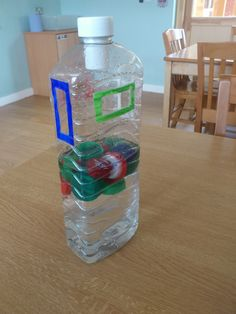TEACCH # Autism # Work task # Work basket # Work Box. Post plastic lids through correct coloured slot. You could add weights to make this a floating/sinking activity.