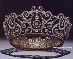 Tiara belonging to Camilla, Duchess of Cornwall.  (Very historical piece and rarely seen until the Queen gave it to Camilla.) This tiara is called the Delhi Durbar Tiara and was made for Queen Mary for the coronation of King George V and Queen Mary when they became Emperor and Empress of India. It was worn with a crimson and ermine cap underneath and at one time actually held diamonds cut from the Cullinan Diamond.
