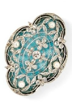 Edwardian Enamel, Pearl, and Diamond Brooch, the shaped blue guilloché enamel with finely pierced platinum mount depicting flowers and foliage, set with one old European-cut diamond, rose-cut diamonds, and pearls, millegrain accents, engraved platinum sides, with gold frame. #Edwardian #antique #brooch