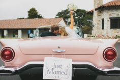 Classic photo in a pink Cadillac. LVL Weddings & Events/ Photography: Cami Jane Photography/ Ceremony: Santa Catalina Chapel/ Reception: Tehama Golf Club/ Floral: Kathryn Smith Flowers/ Linen Rental: LaTavola Linen/ Cake: Parker Lusseau/ DJ: Kelly Productions/ Bride's Gown: Enzoani/ Bridesmaid Dresses: Jenny Yoo/ Bridesmaid Jewelry: J.Crew