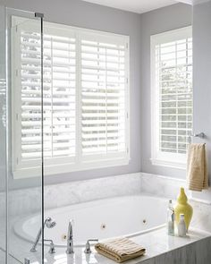 We offer shutters for your windows in a variety of materials, including Wood, Eco-Wood, and Vinyl (Newport). Find out more at Smith & Noble! Bathroom Window Privacy, Bathroom Window Treatments, Bathroom Blinds, Bathroom Sets, Small Bathroom, Master Bathroom, Modern Bathrooms, Dream Bathrooms, Newport