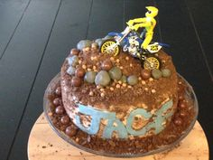 Dirt Bike Cake- crushed up chocolate graham crackers for dirt- fondant rocks and whoppers.