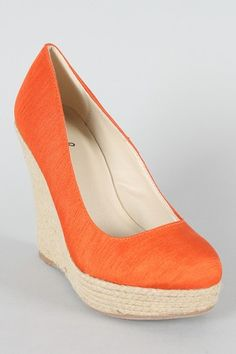 Don't have orange shoes yet....  MUST HAVE