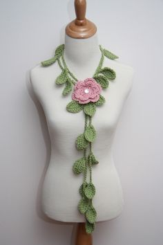 I own this, but also with a blue and white flower so I can switch them out to match my outfit!