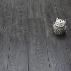 Bold and dramatic, Charcoal Oak doesn't blend into the background, regardless of the décor it enhances. This eye-catching laminate floor has a dark palette that beautifully complements darker shades… Dark Laminate Floors, Dark Timber Flooring, Direct Wood Flooring, Grey Wood Floors, Grey Flooring, Wood Laminate, Stone Flooring, Wooden Flooring, Kitchen Flooring