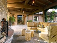 mediterranean patio L shaped chairs in cream multicolored throw pillows three units of tree trunk coffee tables slanted floors of Fascinating and Creative Tree Trunk Table Ideas for Indoor - Outdoor Use Outdoor Spaces, Outdoor Living, Outdoor Decor, Indoor Outdoor, Outdoor Patios, Outdoor Retreat, Outdoor Lounge, Outdoor Ideas, Porches