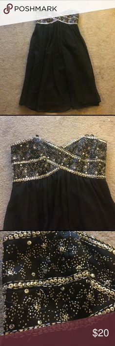 Black homecoming/prom dress Black strapless dress, sweetheart neckline with silver beading in the bust. Found this at Nordstrom rack. Only wore it twice. It's a beautiful dress and would wear again but it's not really my style anymore. Perfect for homecoming/formals! dusk collection Dresses Prom