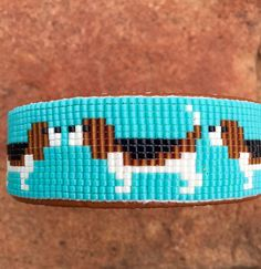 Items similar to Beaded Beagle Bracelet on a turquoise background. This bracelet is a beagle lovers joy. Handmade by the Artist. on Etsy Loom Bracelet Patterns, Peyote Stitch Patterns, Bead Loom Bracelets, Bead Loom Patterns, Jewelry Patterns, Bracelet Designs, Beading Patterns, Beading Ideas, Beading Supplies