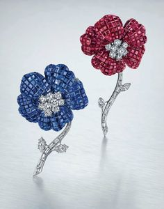 A 'Mystery-Set'' ruby and diamond flower brooch & A 'Mystery-Set' sapphire and diamond flower brooch,; each by Van Cleef & Arpels. Photo Christie's Image Ltd 2015