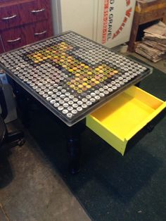 Bottle cap table with epoxy finish #iowa #hawkeyes #black #yellow