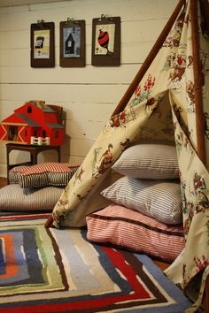 cowboy fabric with ticking pillows. by elsie