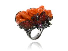 Ring in gold and black rhodium set with coral, sapphires, orange garnets and diamonds by Lydia Courteille, Paris.