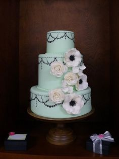 THE color for 2013....Mint!  Handmade sugar flowers and a black pearl swag