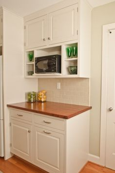Simply white kitchen with wood countertop