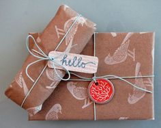 Love the look of white ink on kraft paper (or boxes). If you don't have a stamp, use an opaque white pen. Fun post from Geninne's Art Blog