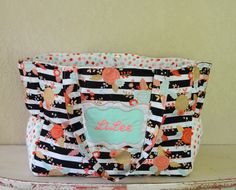 Handmade personalized mega mom floral bag with polka dot accents by LittleDivasCreations on Etsy